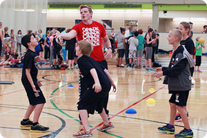 CBE students receiving handball instruction from Canadian athlete